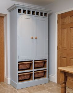 Free standing kitchen pantry cabinet with 4 sliding wicker baskets, 2 solid oak bread drawers and herb racks.
