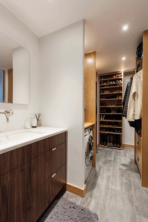 The new wardrobe situation is impressive. A walk-in closet was already in place, but the couple had a better plan to build a more streamlined and highly organized pass-through closet.