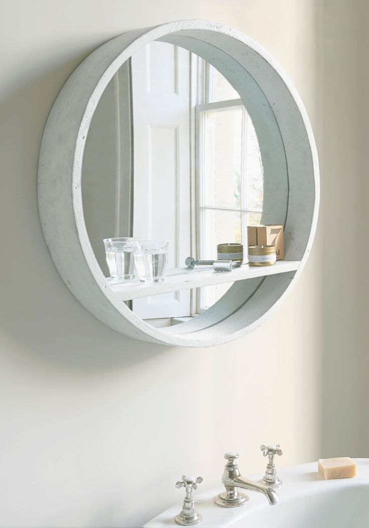 With a nifty shelf for stashing stuff, this clever white mirror is a bit of a goodie-two-shoes! It sits beautifully in hallways, bedrooms and bathrooms alike (to name just a few spots). And is always there to help on the storage front. Mirror, mirrors, wall mirror, floor mirror, mirror homewares, interior, design, furniture, accessories, wall decor, round mirror, oval mirror, shelf mirror, storage mirror