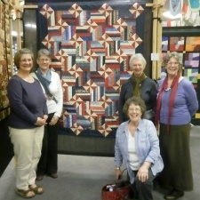 """A quilt made by quilters from Devon, United Kingdom, will be presented to athletes from Portugal competing in the 2012 Olympics in London. The 16-strong village quilting team began work on the project in 2010, after reading an appeal for commemorative blankets to give to Olympic competitors from around the globe. The """"gift of quilts"""" project was seen as a way of presenting visiting athletes with a unique gift of friendship from the people of the United Kingdom. From www.midweekherald.co.uk"""