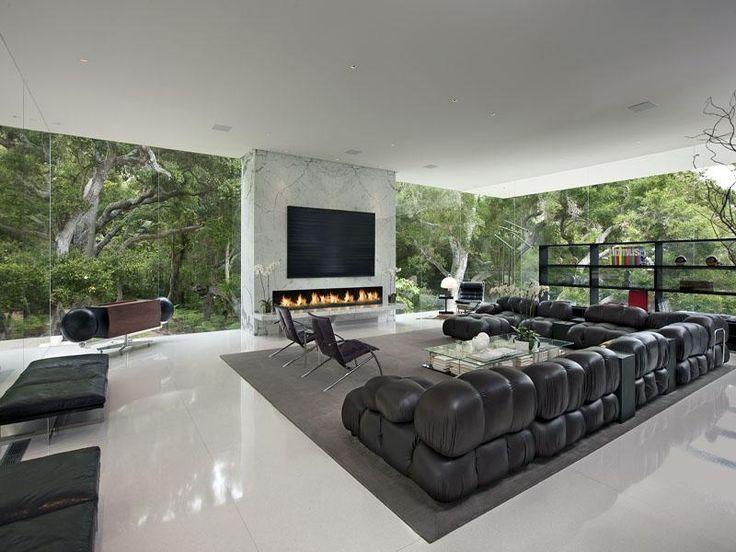Modern Living Room with simple marble tile floors, Built-in bookshelf, stone fireplace, Floor to ceiling windows