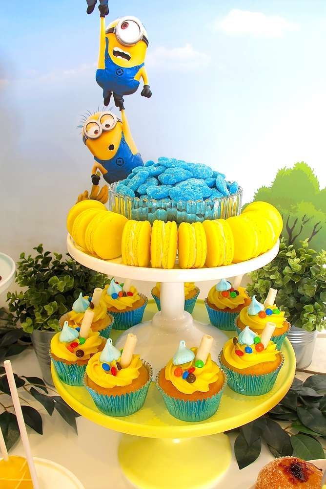 Macarons and cupcakes at a Despicable Me Minions birthday party! See more party ideas at CatchMyParty.com!