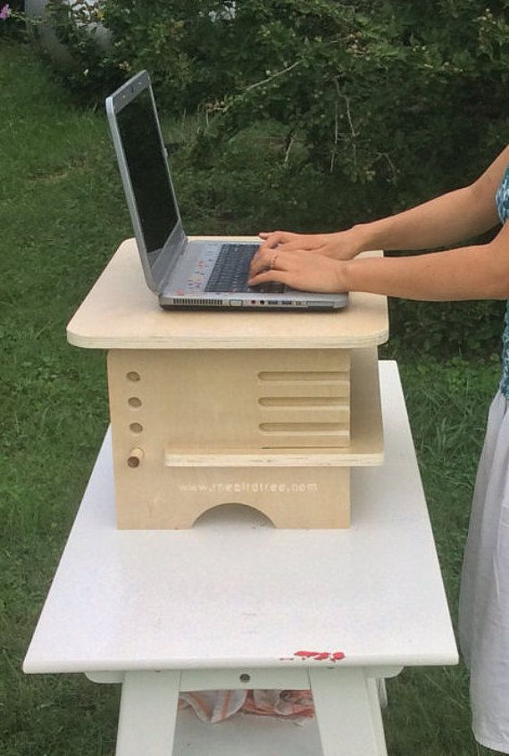 This is a standing desk add-on that also converts to be a lap desk. It is made of 3/4 prefinished plywood (1-sided). We produce them out of a