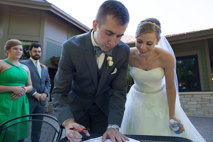 Bride, Groom, Maid of Honor, & Best Man sign the Official Marriage Certificate