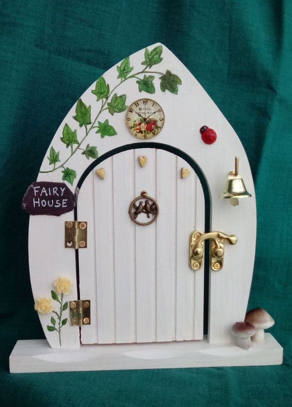 PLEASE NOTE: ALL MY GOODIES CAN BE SHIPPED ONLY BETWEEN 10-12TH OF OCTOBER OR AFTER THE 1ST OF NOVEMBER!  Wooden fairy door decorated by me with several technique like decoupage, hand painting etc. Has glass clock, roses, hand painted ivy, wooden ladybug, metal bell, slate, mushrooms etc. It is fragile so it is not a toy for small children.  I can make similar fairy doors for order as well.  Measures: 21cm x 18.5cm MADE IN NORTH WALES.