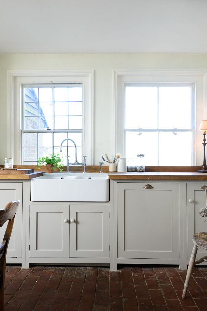 The beautiful Lidham Hill Farm Kitchen is painted in 'Mushroom'