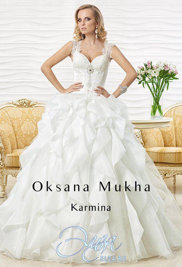 Cвадебное платье Кармина: пышное платье (бальное), стиль звибел, длинное платье, с фигурным вырезом, с очень пышной юбкой, без шлейфа, модель до 2016 года, платье, в ограниченном количестве, юбка с воланами, широкие бретельки, основная ткань: кружево, атлас, органза