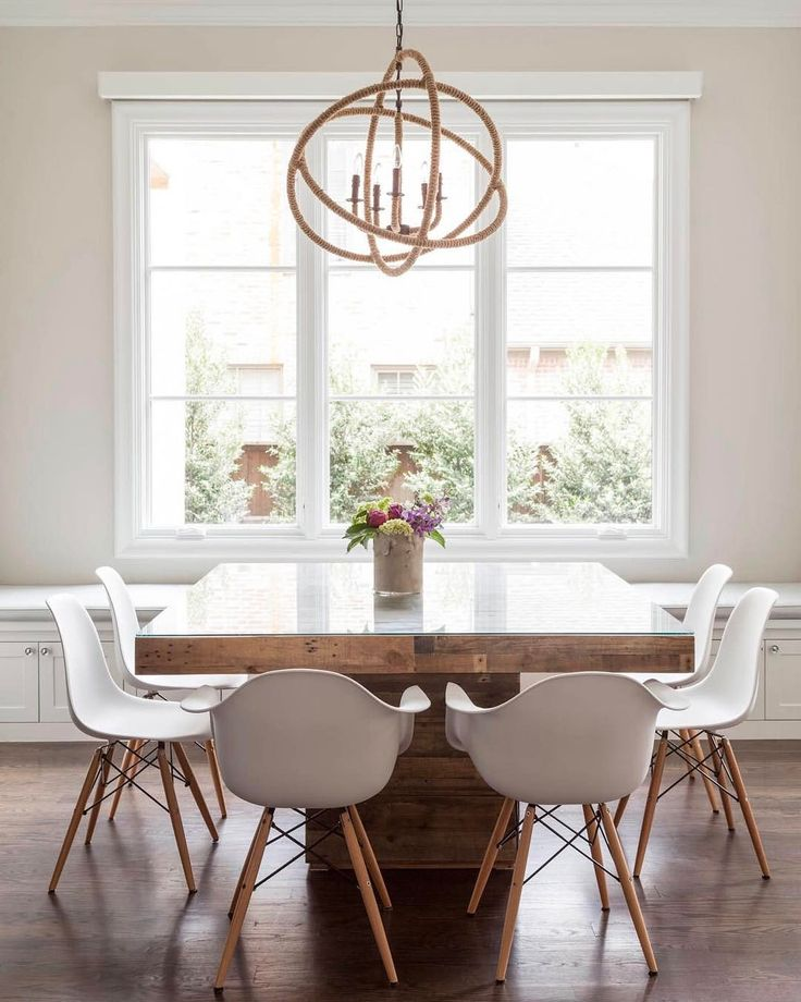 dining rooms home decor dining room features a rope sphere chandelier hanging over a square wood dining table with glass top lined with eames