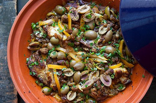 A traditional Moroccan dish of chicken pieces braised with spices, garlic, onion, olives, and preserved lemon.  Cooked in a tagine.
