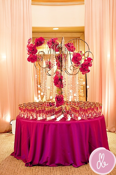 filled champagne glasses with guest names & table number attached to it. Sparkling grape juice for those who don't imbibe, with a little P.S. to them would be a good compromise...