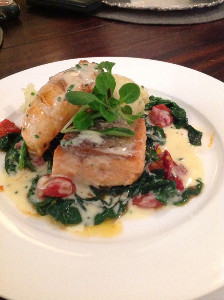 Duo of grilled Scottish Salmon and Lobster Tail accompanied by Potato Mousse, sautéed Baby Spinach and Tomatoes  finished with a White Port Wine Sauce