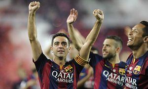 Barcelona midfielder Xavi Hernández celebrates one final trophy following his side's victory in the