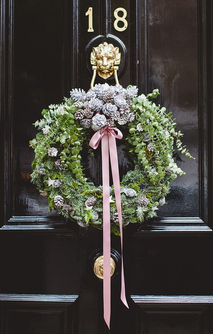 Christmas wreath with eucalyptus, blue pine and pine cones, decorated with ribbon. http://wishwishwish.net/2014/12/christmas-in-london/