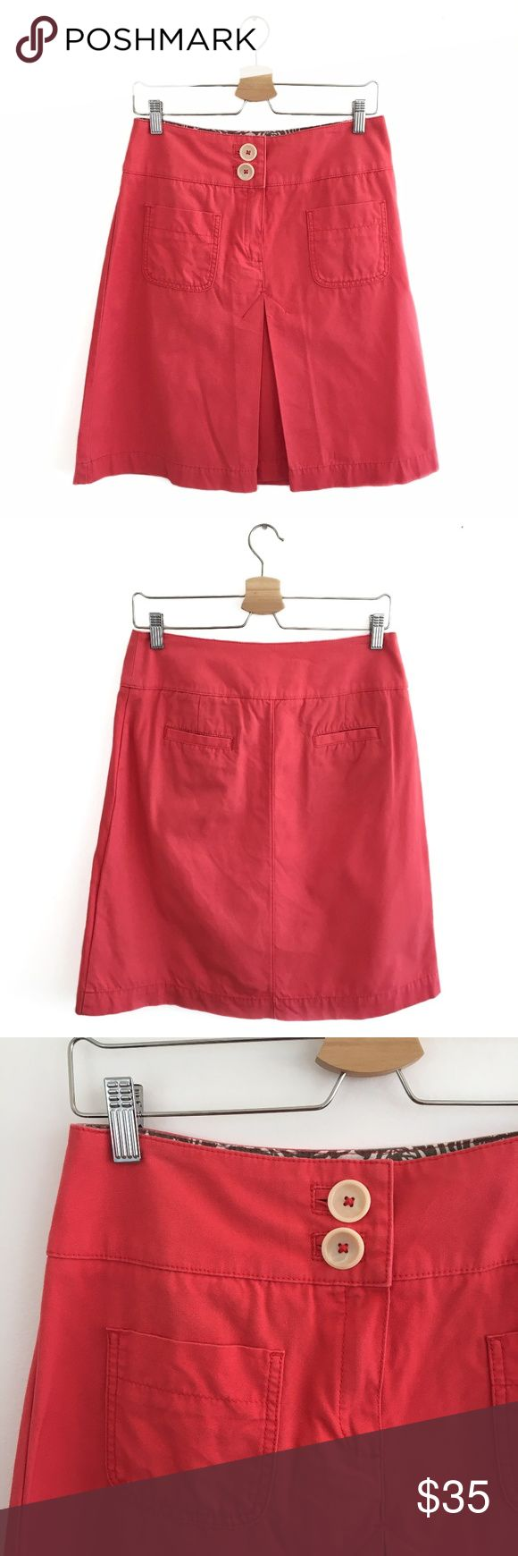 """Boden Inverted Pleat Knee Length Skirt in Coral 12 Boden Inverted Pleat Knee Length Skirt in Coral. Size 12. Excellent Used Condition. No visible flaws. SUPER cute skirt for spring!! Pleated Front. Zipper and 2 adorable button closures. 100% Cotton. Machine Wash. Lay flat to dry. Waist: 14.5"""". Length: 21.5"""" Boden Skirts Midi"""