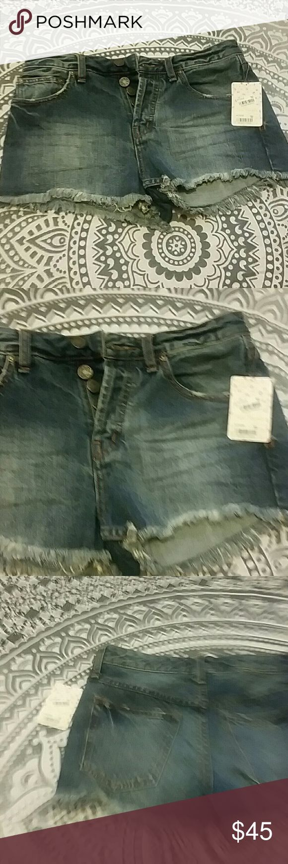 Free people cutoff jean denim shorts 27 nwt Nwt free people cutoff blue jean shorts , front and back pockets, button fly, belt loop, distressed details, smoke and pet free home. Size 27 womens, runs true to size Free People Shorts Jean Shorts