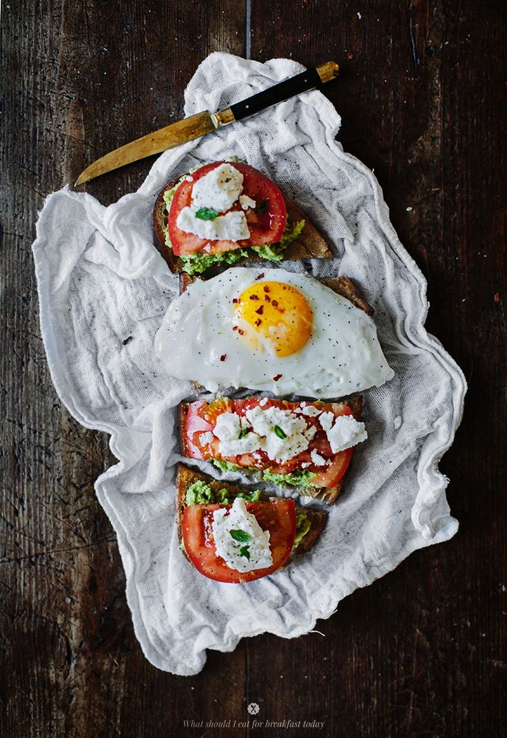 avocado toast with goat cheese and tomato.
