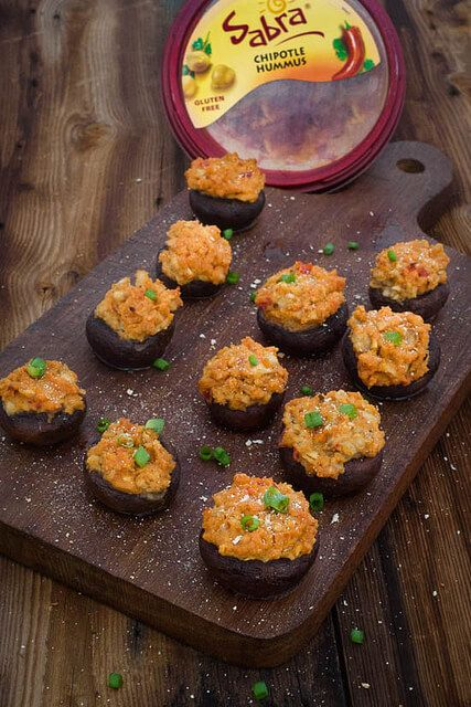 These hummus stuffed mushrooms are the perfect easy tailgating appetizer! So easy to whip up and have just enough kick to keep you coming back for more! [W]hen Sabra asked us to partner with them to make up a delicious tail gating recipe I knew it was going to have to be manly. Tail gating=tons …