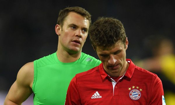 Bayern Munich's midfielder Thomas Mueller (R) and Bayern Munich's goalkeeper Manuel Neuer react after the German first division Bundesliga football match between Borussia Dortmund and FC Bayern Munich in Dortmund on November 19, 2016. / AFP / PATRIK STOLLARZ / RESTRICTIONS: DURING MATCH TIME: DFL RULES TO LIMIT THE ONLINE USAGE TO 15 PICTURES PER MATCH AND FORBID IMAGE SEQUENCES TO SIMULATE VIDEO. == RESTRICTED TO EDITORIAL USE == FOR FURTHER QUERIES PLEASE CONTACT DFL DIRECTLY AT + 49 69…