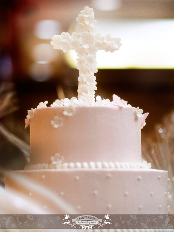 i don't think i like the cross like that but maybe a smaller version somewhere on the cake, not standing up. @Sylvia Dolgos