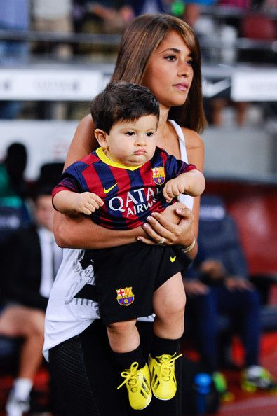 Antonella Roccuzzo and her son Thiago Messi walk onto the pitch prior to the La Liga match between FC Barcelona and Real Sociedad de Futbol at Camp Nou on September 24, 2013 in Barcelona, Spain.