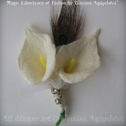 corsage with calla lily and peacock feather