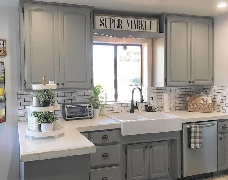 Light Grey Stained Kitchen Cabinets with White tile Backsplash and white Countertops