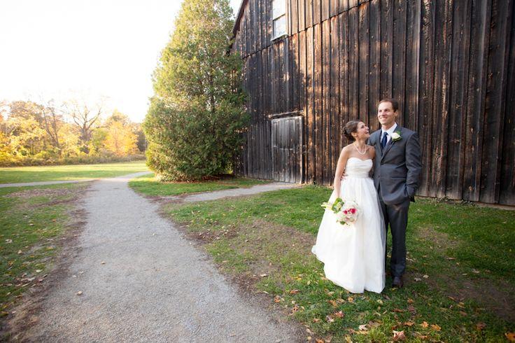 Vineland Estates bride and groom in front of old wood barn