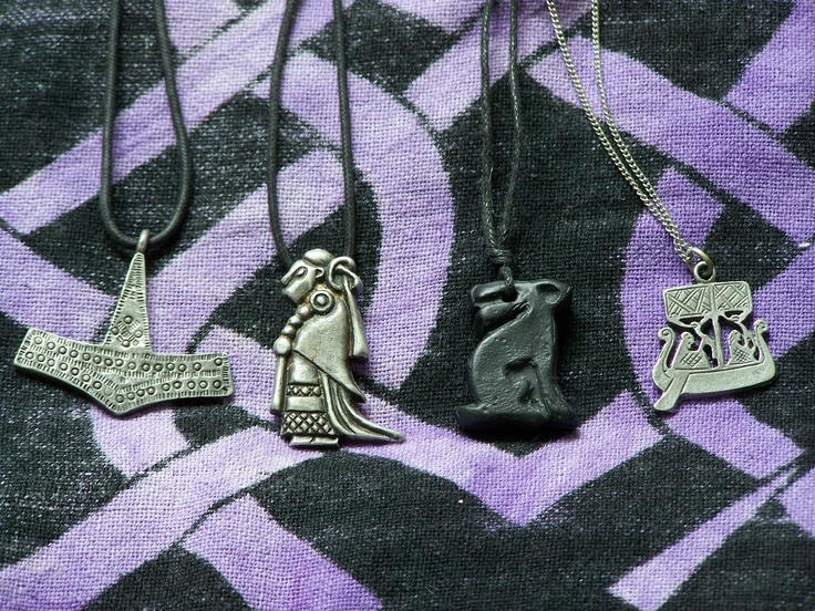 Norse Talismans - From Left to Right: My first Pewter Thor's Hammer (Jorvik Viking Centre) bought at my first Jorvik Viking Festival 2008, Valkyrie in Pewter (Jorvik Centre 2009) taken from a viking stone picture carving in Sweden I think, bought as a personal treat for completing my degree, Moon Gazing Hare (Jorvik Viking Fest 2009, medieval market) which is a animal and symbol linked to Freya and Travellers in Ship pendant in Pewter (Jorvik Centre 2010).