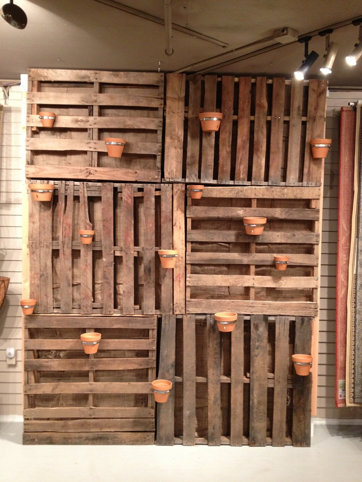 garden wall made from pallets added air duct straps to on pallet wall id=13940