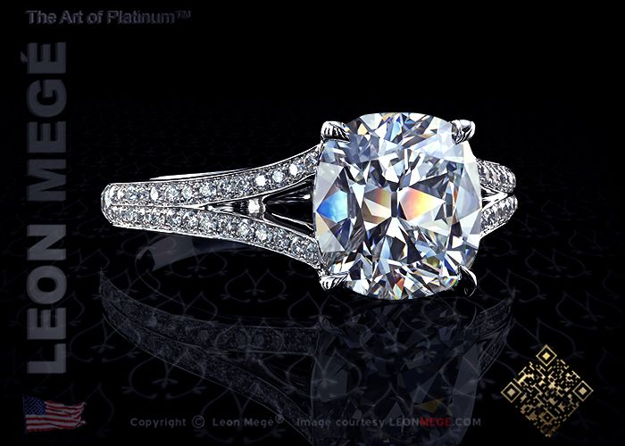 Split shank solitaire engagement ring featuring a cushion cut diamond and micro pave by Leon Megé