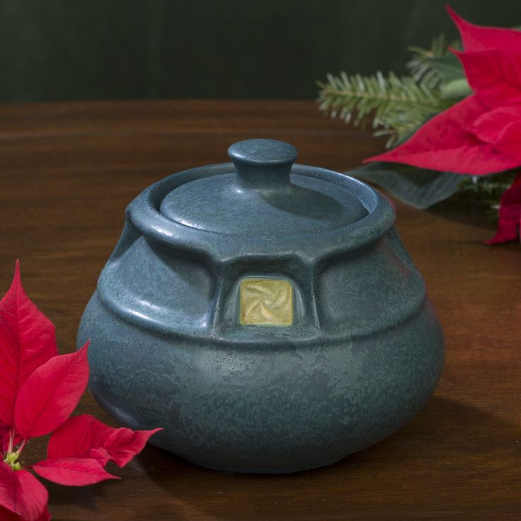 """The Craftsman Rose is a classic motif that never goes out of style. Here it appears framed in a windowpane pattern that accents its square shape. The full, round belly of the bowl provides a contrasting softness that is echoed in the handle of the jar's lid.  -the exact piece is shown in the photos -thrown, sculpted & glazed by hand -approximate 4.75""""H x 4.75""""W -traditional earthenware art pottery is porous, liner recommended for use with water  Available to ship within 2 bu..."""