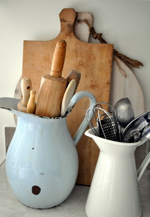 Cooking utensils in vintage hugs and pitchers - far more beautiful that shoving them in a drawer!