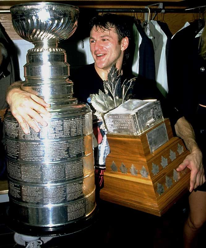 Claude Lemieux holds onto two trophies he won in 1995 - The Stanley Cup and Conn Smythe.
