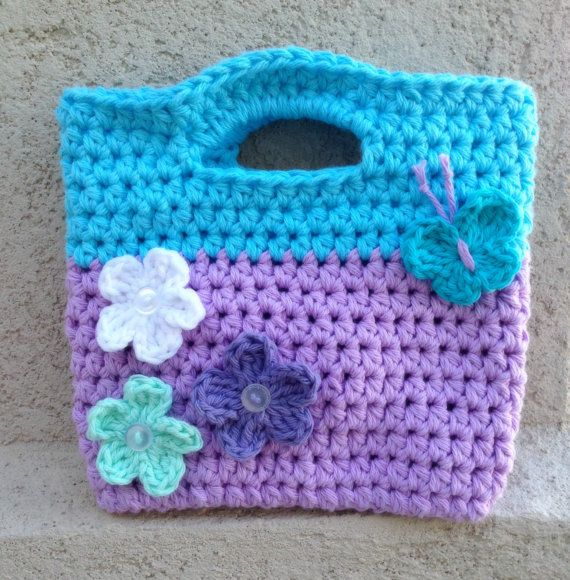 This crochet purse in lavender and cupcake blue is the perfect accessory for any little girl. The purse is crocheted with two strands of 100%