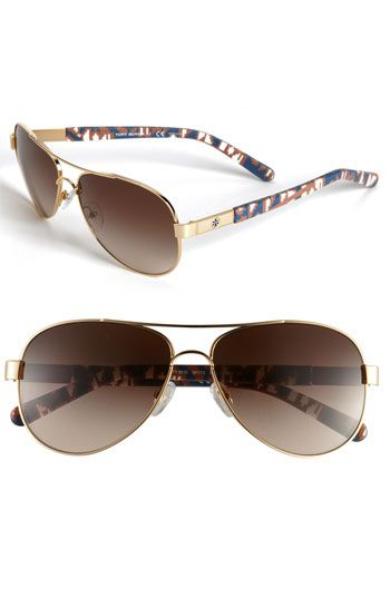 Tory Burch Aviator Sunglasses. Available at Monkee's of Morrocroft, 704-442-7337.