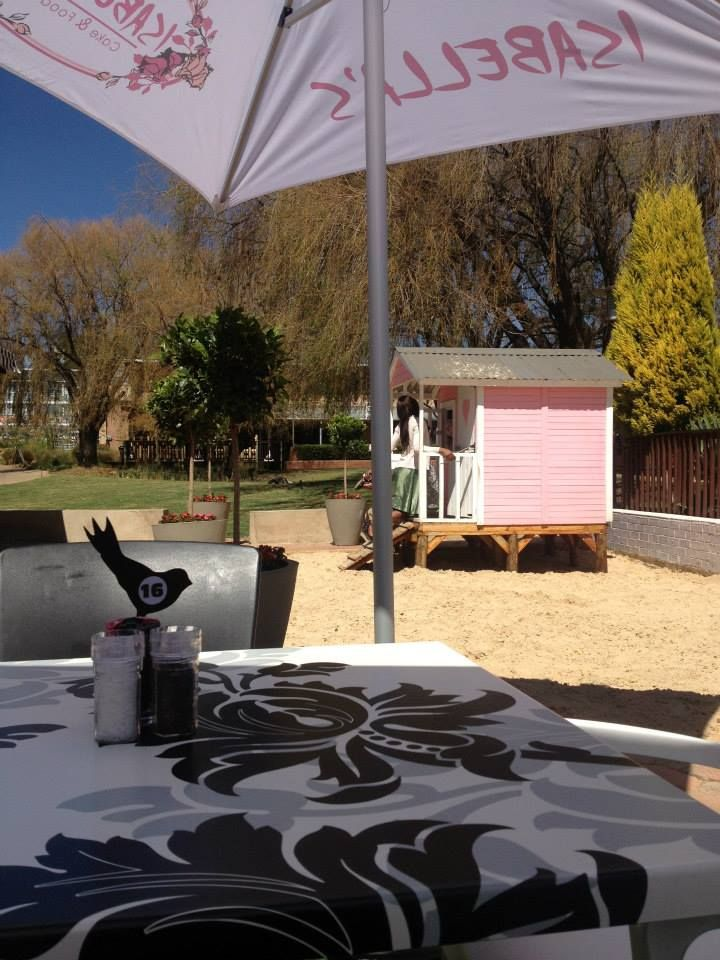 Keep an eye on us while we play, Mom!  Relax, in the shade, with a decadent slice of cake while the Petite's play in our doll house and sand pit.  Fun for everyone!