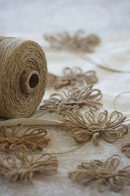 Twine flowers - super easy, and super cute!   Click on the tutorial for directions.  I could see making these for bows on gift wrap, framing them behind glass for wall art, adding a clip to the back for little girls' hair accessories, gluing to a vase or lamp shade.....the possibilities are endless!  :)