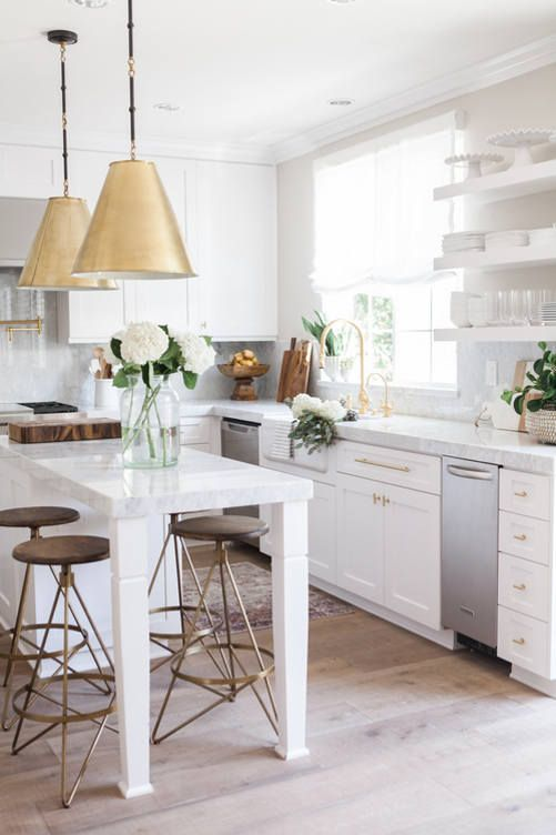 White kitchen with brass accents by interior designer Nicole Davis (via Desire to Inspire).