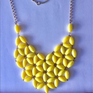 I just added this to my closet on Poshmark: Yellow Statement Necklace from Carrie Grace Shop. Price: $5 Size: OS