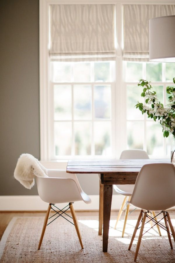 Dining- Kendall charcoal by BM on the wall, farmhouse table, Eames chairs with wooden legs, Seagrams rug, sheepskin throw
