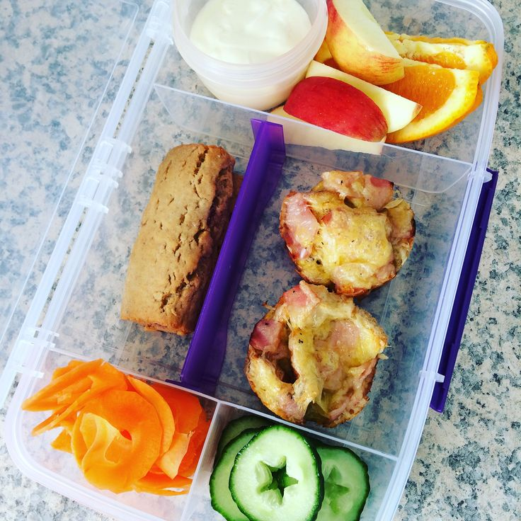 Lunch box ideads : Greek and honey yoghurt, Apple, orange, homemade fruit filled bar, spiralized carrot, cucumber, bread and egg muffins