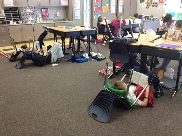 During quiet reading time, just have the kids flip their chairs around and give them pillows to lounge on. | 35 Money-Saving Classroom DIYs For Teachers On A Budget