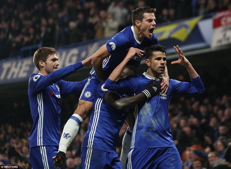 (Left-to-right) Marcos Alonso, Cesar Azpilicueta and Victor Moses - who provided the assist - celebrate with the forward