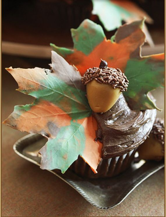 Autumn cupcake. Here is a link with directions for how to make edible chocolate leaves: http://thepartiologist.blogspot.com/2011/09/chocolate-maple-leaf-cake.html