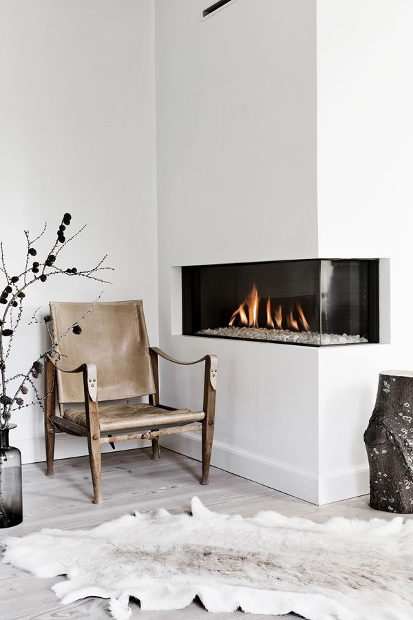 leather chair by a fireplace