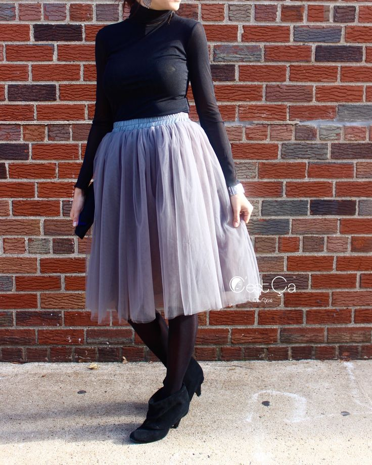 Semi-puffy ash gray soft tulle skirt. 4 layers of soft tulle. Lined. Below knee midi length. Designed in New York. Handmade. Available in other colors.
