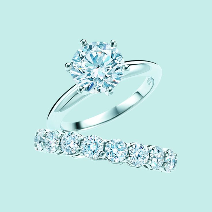 Love the single stone and the multiple stone band! The Tiffany® Setting engagement ring in platinum with diamonds and shared-setting diamond band ring. #TiffanyPinterest