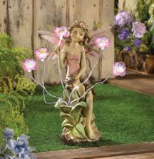 Peony Fairy Statue with Solar Flower Lights  Add this beautifully detailed peony solar fairy statue to your garden, deck, patio or any favorite outdoor setting. http://www.mysolarshop.com/peony-solar-fairy-statue-13915