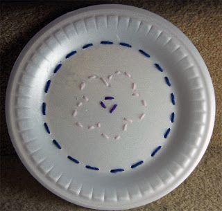 Teach Girl Scouts how to sew/embroider using a stryofoam plate.