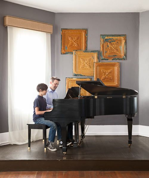A small stage is the perfect setting for this music-loving family's peformances. | Photo: Lisa Romerein | thisoldhouse.com